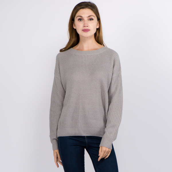 """Solid color knitted sweater featuring criss cross v neck back details.  - One size fits most 0-14 - Approximately 21"""" in length - 100% Acrylic"""