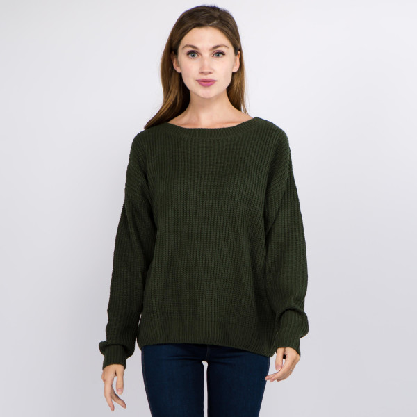 "Solid color knitted sweater featuring criss cross v neck back details.  - One size fits most 0-14 - Approximately 21"" in length - 100% Acrylic"