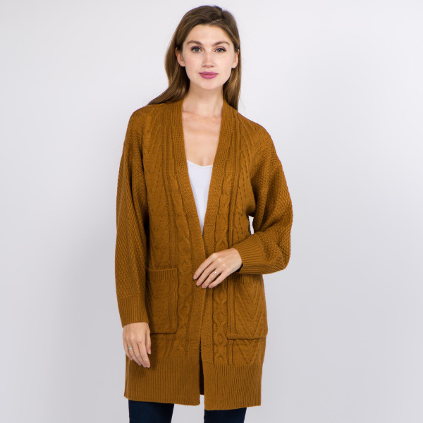"Solid color cable knit knitted cardigan with front pocket details.  - One size fits most 0-14 - Approximately 32"" in length - 100% Acrylic"