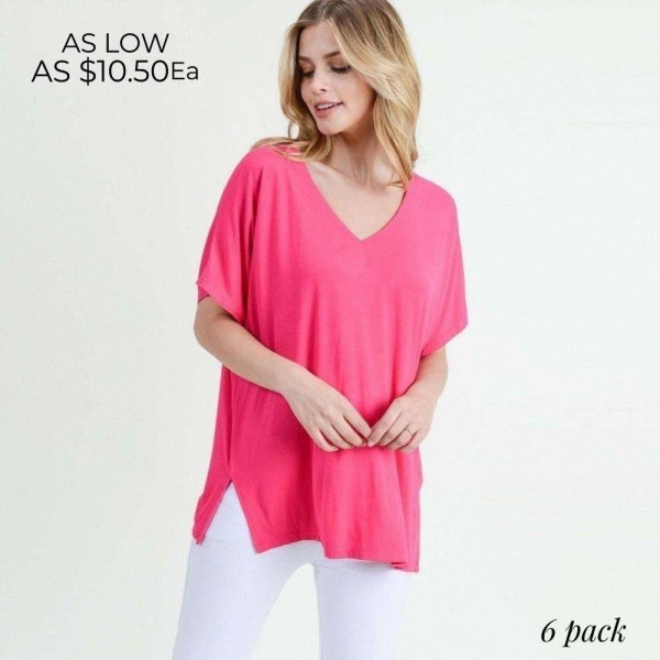 "Solid short sleeve oversized v-neck tee featuring side slit details. Approximately 25"" in length.  • Short sleeves, v-neck  • Oversized silhouette  • Side slit accents  • Soft and stretchy  • Pullover styling  • Style with leggings or jeans for an effortless look  • Soft and stretchy  • Imported   - Pack Breakdown: 6pcs / pack  - Sizes: 2S / 2M / 2L  - Composition: 95% Rayon, 5% Spandex"