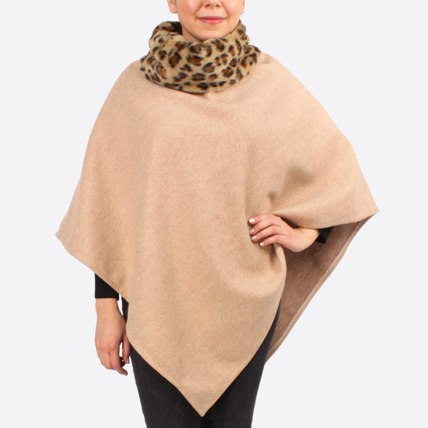 "Faux fur leopard print cowl neck poncho.  - One size fits most 0-14 - Approximately 30"" in length - 100% Polyester"