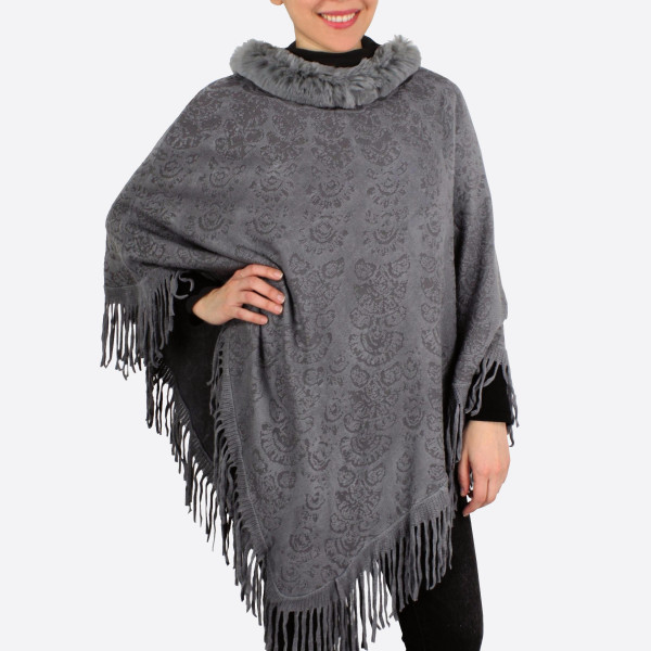 """Faux fur neckline knit poncho with fringes.  - One size fits most 0-14 - Approximately 34"""" in length - 100% Acrylic"""