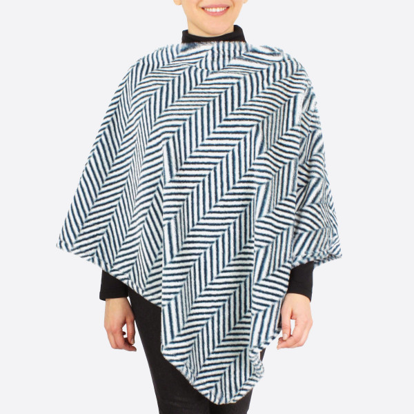 "Faux fur herringbone print poncho.  - One size fits most 0-14 - Approximately 36"" in length - 100% Polyester"