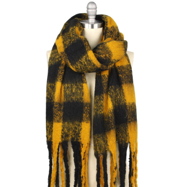 "Buffalo check oversized oblong scarf with fringes.  - Approximately 19.5"" W x 70.5"" L. Fringes approx 5.5"" L - 100% Polyester"