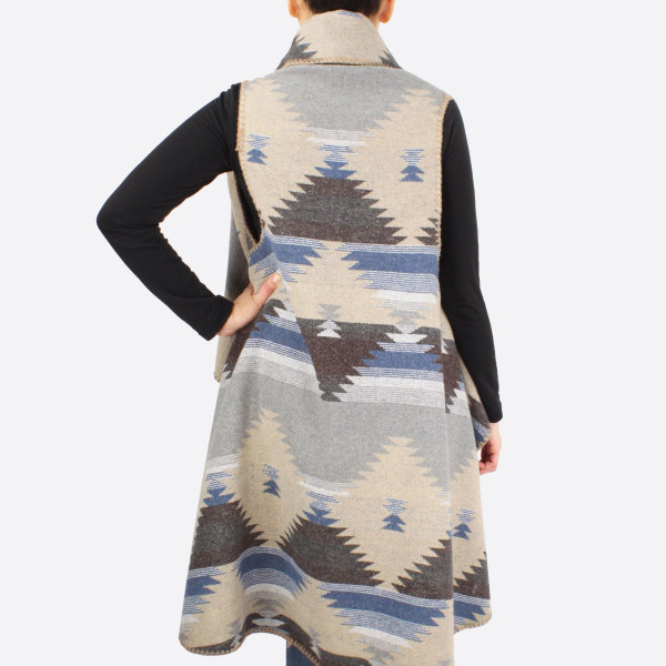 """Round vest with western pattern details.  - One size fits most 0-14 - Approximately 44"""" in length - 100% Polyester"""