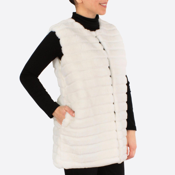 """Stripe texture faux fur vest with pocket details.  - One size fits most 0-14 - Approximately 28"""" in length - 100% Polyester"""