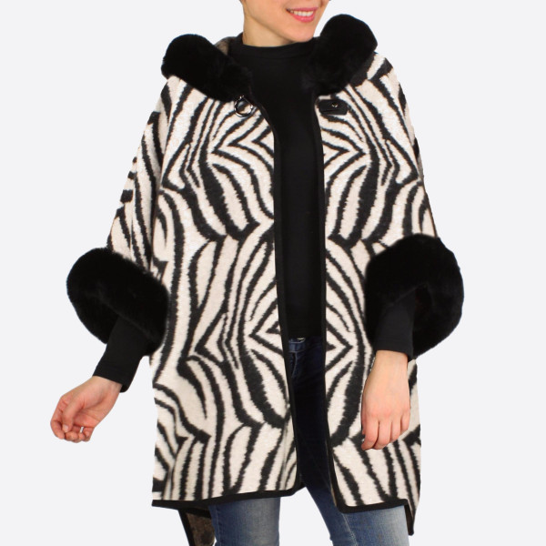 "Faux fur trim zebra print cape/ruana.  - One size fits most 0-14 - Approximately 30"" in length - 100% Acrylic"