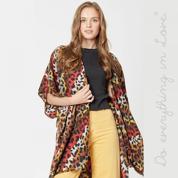 "Do everything in Love brand lightweight multicolor leopard print kimono.  - One size fits most 0-14 - Approximately 37"" L - 100% Viscose"