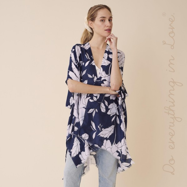"Do everything in Love brand lightweight flower kimono.  - One size fits most 0-14 - Approximately 37"" L - 100% Polyester"