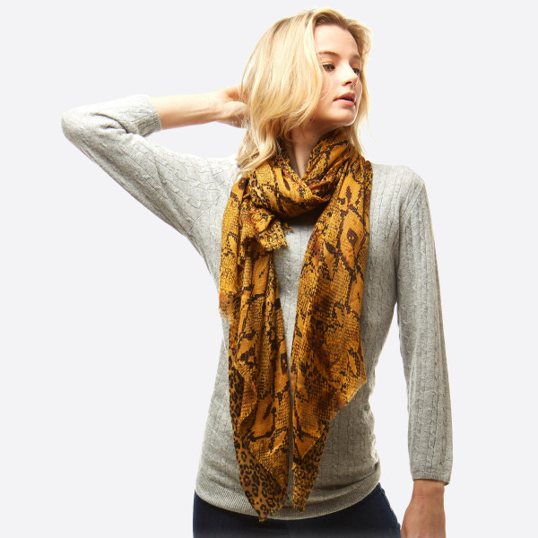 """Lightweight multi animal print oblong scarf.  - Approximately 35"""" W x 70"""" L - 100% Polyester"""