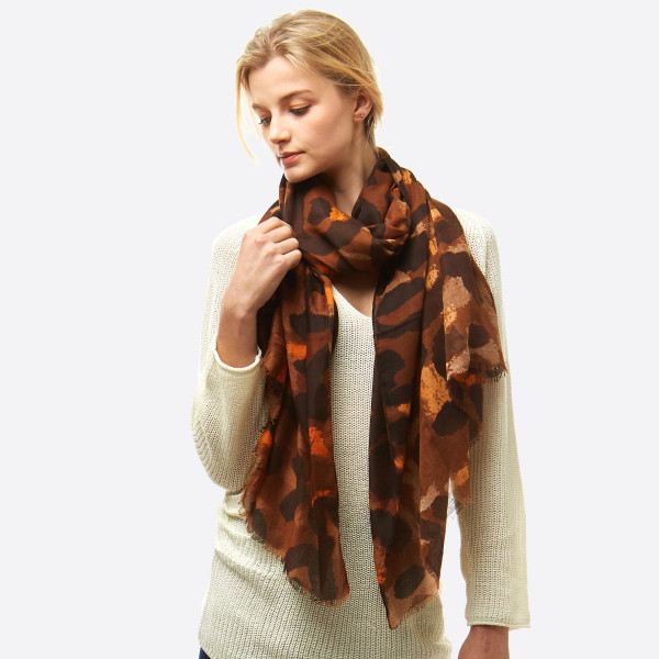 """Lightweight leopard print oblong scarf.  - Approximately 36"""" W x 72"""" L - 100% Polyester"""