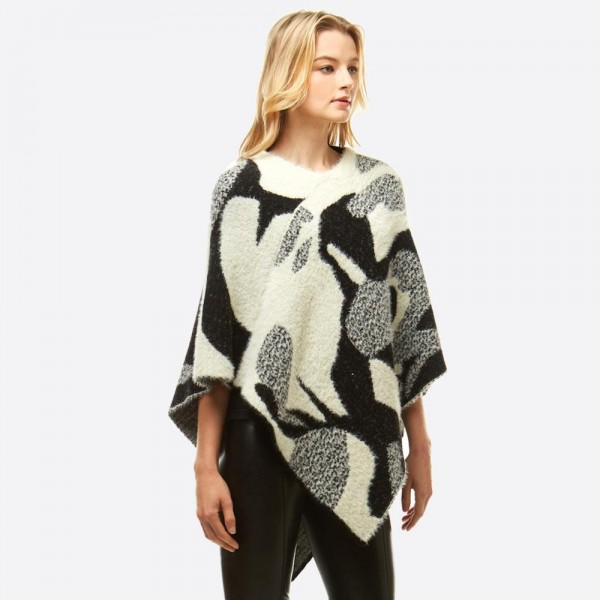 "Abstract print chenille poncho.  - One size fits most 0-14 - Approximately 25.5"" in length - 60% Nylon, 40% Acrylic"