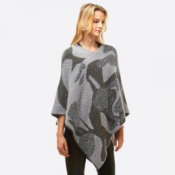 """Abstract print chenille poncho.  - One size fits most 0-14 - Approximately 25.5"""" in length - 60% Nylon, 40% Acrylic"""