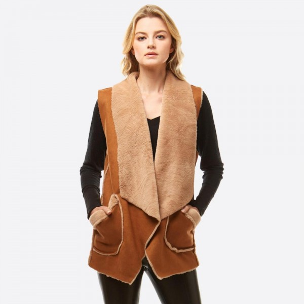 """Faux suede fur lined vest with pocket details.  - One size fits most 0-14 - Approximately 29"""" in length - 100% Polyester"""