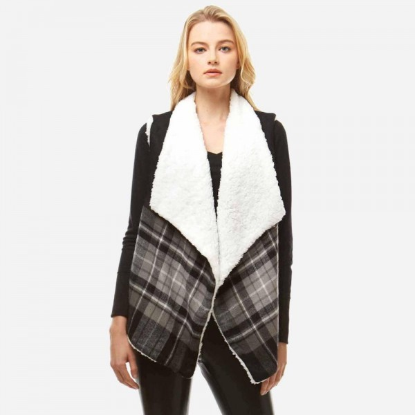 """Plaid print faux sherpa lined vest.  - One size fits most 0-14 - Approximately 25"""" in length - 100% Polyester"""