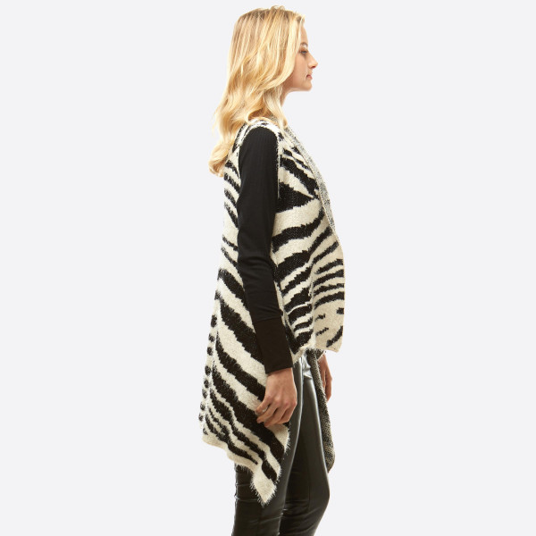 "Fuzzy zebra print vest.  - One size fits most 0-14 - Approximately 28"" in length - 100% Acrylic"