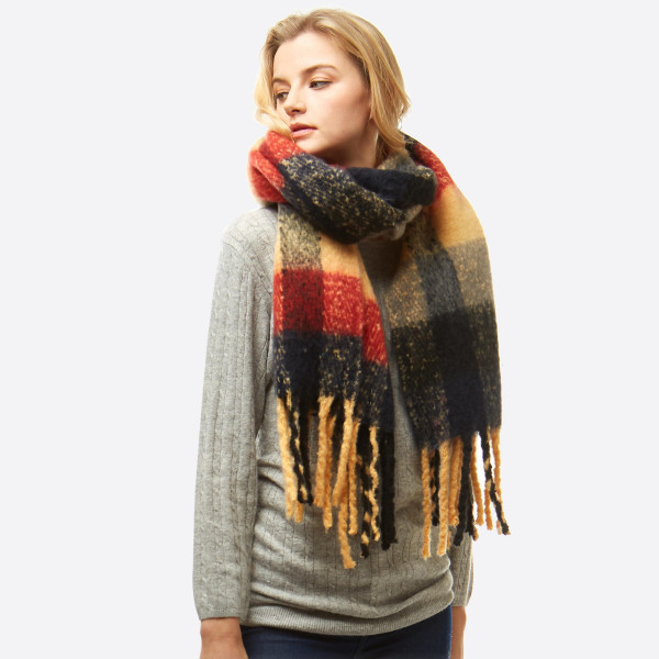 "Oversized fuzzy plaid oblong scarf with fringes.  - Approximately 19"" W x 86"" L - 100% Polyester"