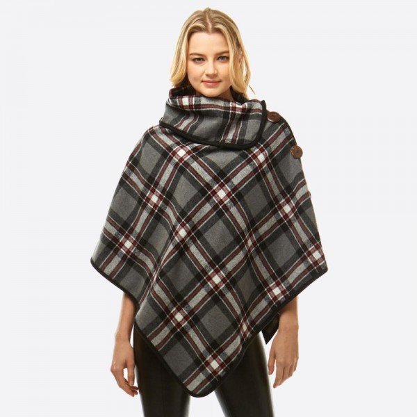 """Plaid print turtleneck poncho with snap and wood button details.   - One size fits most 0-14 - Approximately 34"""" in length - 100% Polyester"""