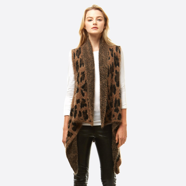 """Fuzzy leopard print vest.  - One size fits most 0-14 - Approximately 26"""" in length - 100% Acrylic"""