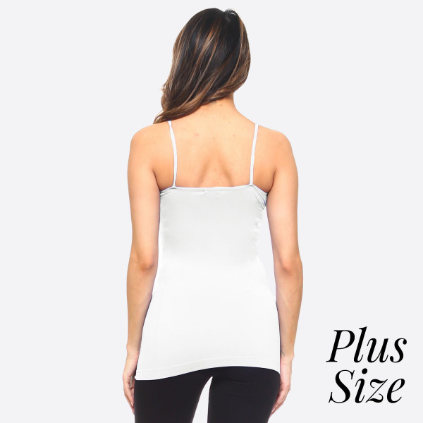 "Women's solid Plus size seamless camisole tank top.  • Spaghetti straps  • Seamless design for extra comfort  • Longline hem  • Soft and stretchy  • Fits like a glove  • Perfect for layering under sheer tops or by itself  • Imported  - One size fits most plus 16-22 - Approximately 18"" L - 92% Nylon, 8% Spandex"