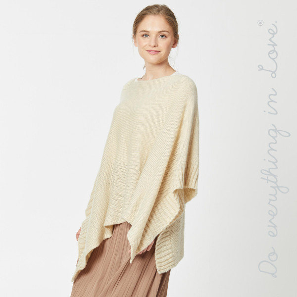 "Do everything in Love brand solid color yarn knitted poncho.  - One size fits most 0-14 - Approximately 21"" L - 100% Acrylic"