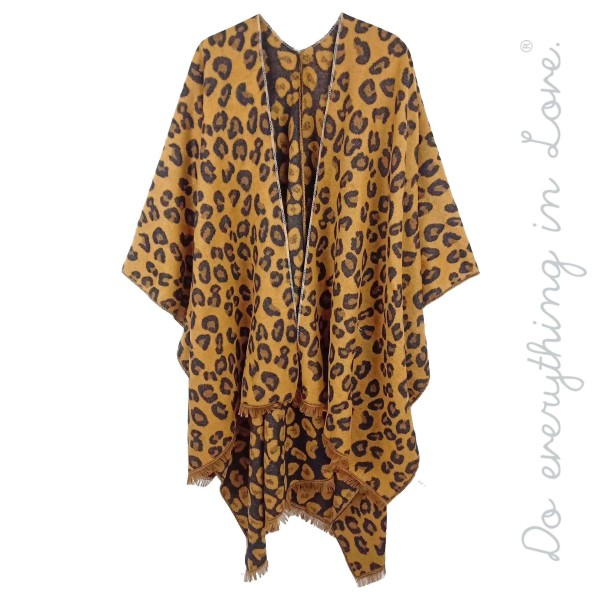"Do everything in Love brand cozy leopard print kimono.  - One size fits most 0-14 - Approximately 36"" L - 90% Acrylic, 10% Polyester"