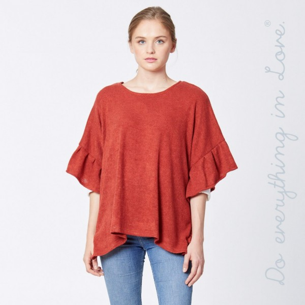 "Do everything in Love brand solid color short sleeve ruffle trim poncho.  - One size fits most 0-14 - Approximately 25"" in length - 100% Acrylic"