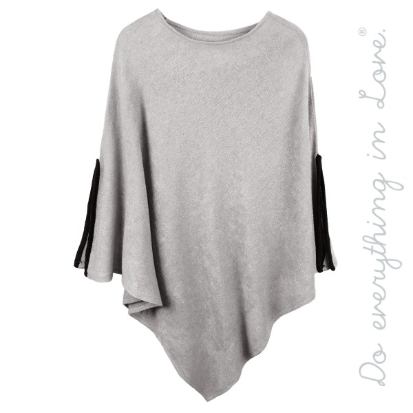 """Do everything in Love brand solid color thin knit poncho sleeve slit details.  - One size fits most 0-14 - Approximately 38"""" L - 100% Acrylic"""