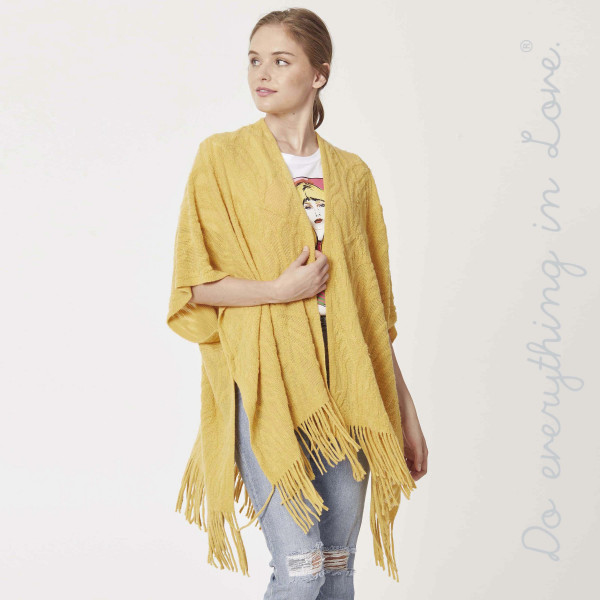 "Do everything in Love brand open knit kimono with fringes.  - One size fits most 0-14 - Approximately 32"" L - 100% Acrylic"