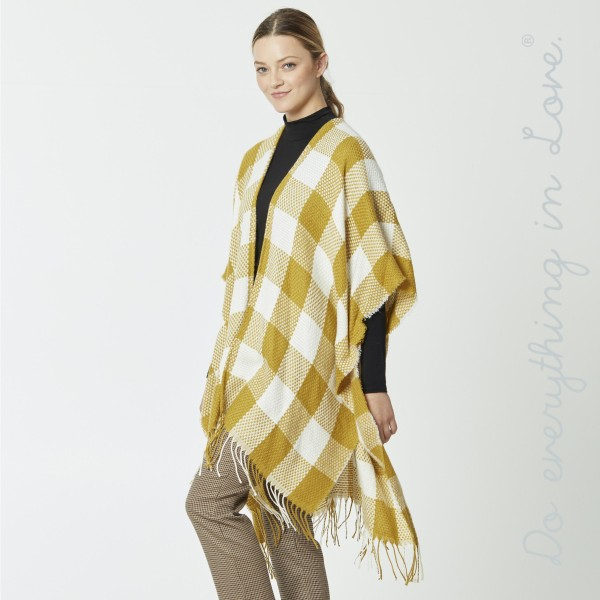 """Do everything in Love brand buffalo check kimono with fringes.  - One size fits most 0-14 - Approximately 39"""" L - 100% Acrylic"""
