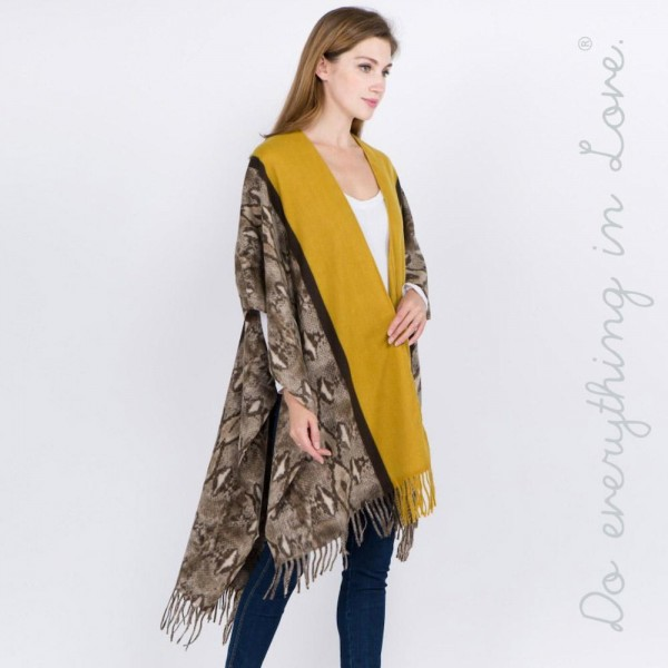 """Do everything in Love brand soft touch snakeskin bordered ruana with fringes.  - One size fits most 0-14 - Approximately 40"""" L - 70% Polyester, 30% Viscose"""