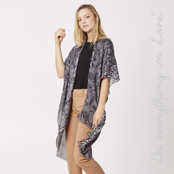 "Do everything in Love brand lightweight snakeskin kimono.  - One size fits most 0-14 - Approximately 37"" L - 100% Polyester"