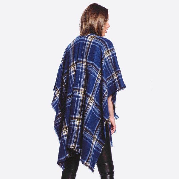 """Soft touch plaid print ruana/shawl.  - One size fits most 0-14 - Approximately 35"""" L - 100% Polyester"""