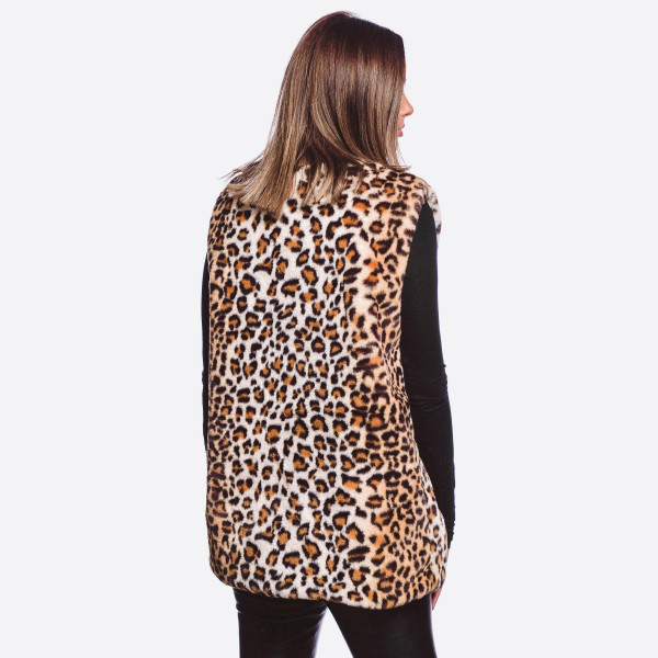 """Faux fur leopard vest featuring pocket details with hook and eye closure.  - One size fits most 0-14 - Approximately 26"""" L - 100% Polyester"""