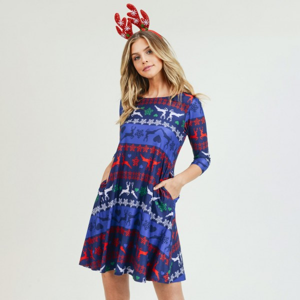 """Women's Christmas fair isle reindeer print A-Line dress with pocket details.  • 3/4 length sleeves • Crew neck • Two side seam pockets to keep your hands warm • A-line silhouette • Fair isle reindeer print • Soft and comfortable fabric with stretch • Perfect for styling with heels or booties • Imported  - Pack Breakdown: 6pcs / pack - Sizes: 2S / 2M / 2L - Approximately 34"""" in L - 95% Polyester, 5% Spandex"""