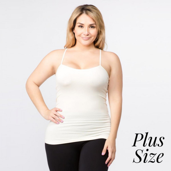 "Solid color plus size seamless camisole tank top.  • Spaghetti straps  • Seamless design for extra comfort  • Longline hem  • Soft and stretchy  • Fits like a glove  • Perfect for layering under sheer tops or by itself  • Imported  - One size fits most plus 16-22 - Approximately 18"" in length - Composition: 92% Nylon, 8% Spandex"