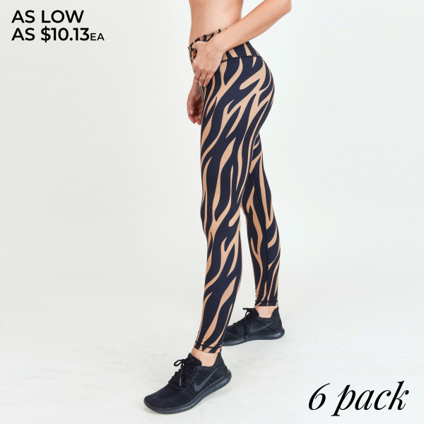 """Tiger striped athletic leggings.  • Mid rise waistband features a hidden pocket for keys, cash, phone  • Vibrant tiger stripe pattern  • 4-way stretch for a move with you feel  • Flatlock seams prevent chafing, triangle crotch gusset eliminates camel toe  • Moisture wick fabric  • Fits like a glove  • Full length design  • Perfect for all low to high impact workouts   - Pack Breakdown: 6pcs / pack - Sizes: 2S / 2M / 2L - Inseam approximately 27"""" L - Composition: 46% Polyester, 41% Nylon, 13% Spandex"""