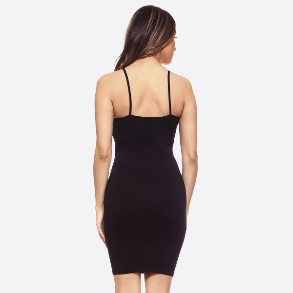 """Solid color seamless cami slip dress.   • Thin, comfortable straps  • Fits like a glove  • Soft and stretchy  • Seamless design for comfort  • Short length hem  • Imported   - One size fits most 0-14 - Approximately 26"""" in length - Composition: 92% Nylon, 8% Spandex"""