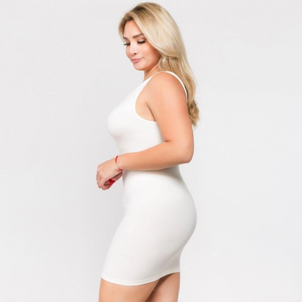 """Solid color seamless tank top slip dress.  • Sleeveless  • Scoop neckline  • Fits like a glove  • Soft and stretchy  • Seamless design for comfort  • Short length hem  • Imported  - One size fits most plus 16-22 - Approximately 28"""" L - Composition: 92% Nylon, 8% Spandex"""