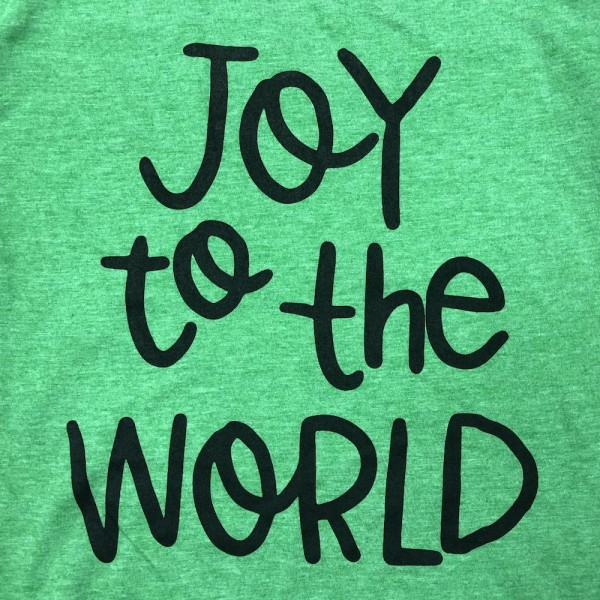 "Green Anvil Lightweight short sleeve ""Joy to the world"" Christmas printed boutique graphic tee.  - Pack Breakdown: 6pcs / pack - 1-S / 2-M / 2-L / 1-XL - 65% Polyester, 35% Cotton"