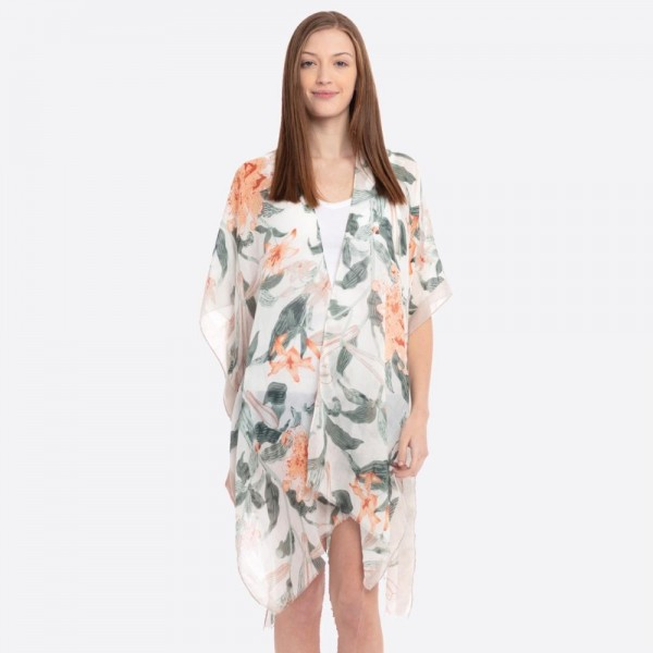"Lightweight solid bordered floral kimono.  - One size fits most 0-14 - Approximately 37"" L - 100% Polyester"