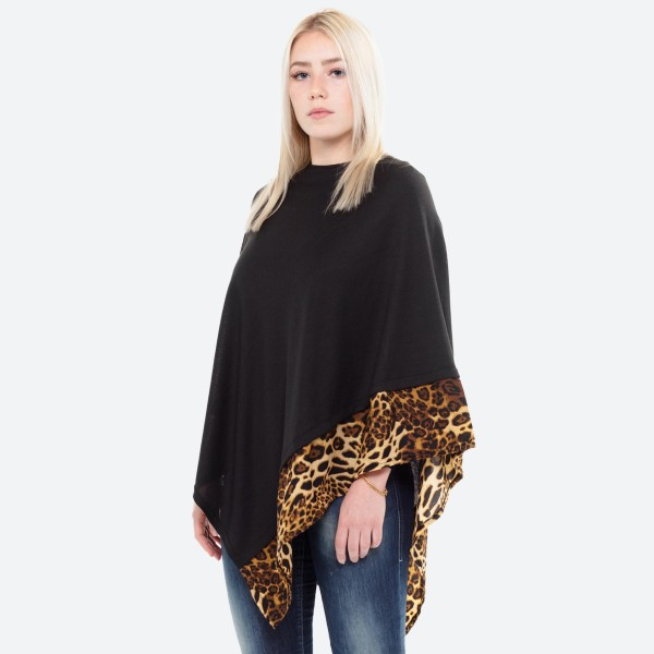 """All year around solid black poncho with leopard print trim.  - One size fits most 0-14 - Approximately 27"""" L - 100% Acrylic"""
