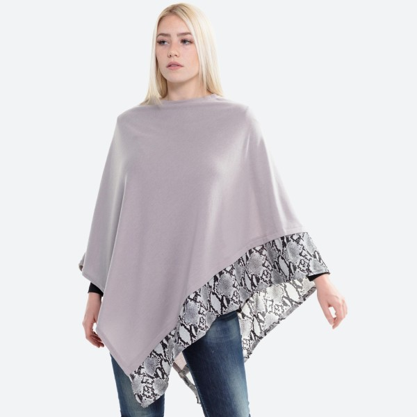 """All year around solid grey poncho with snakeskin trim.  - One size fits most 0-14 - Approximately 27"""" L - 100% Acrylic"""