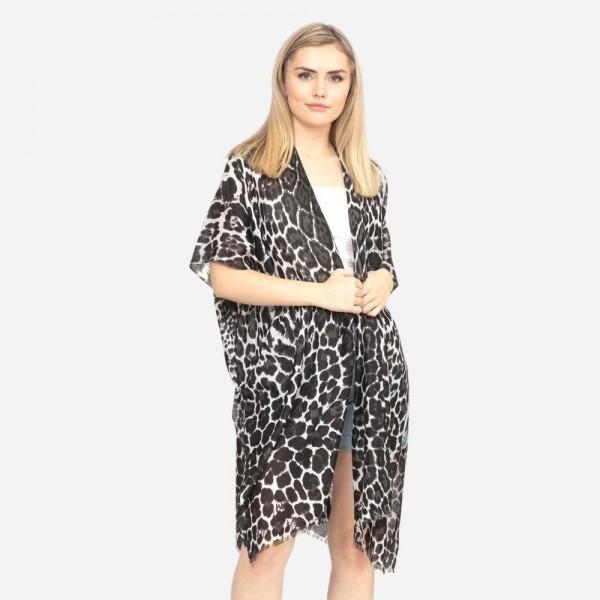 "Multi size mix leopard print kimono.  - One size fits most 0-14 - Approximately 37"" L - 100% Polyester"