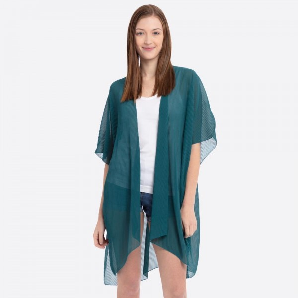 "Solid color pleated kimono.  - One size fits most 0-14 - Approximately 37"" L - 100% Polyester"