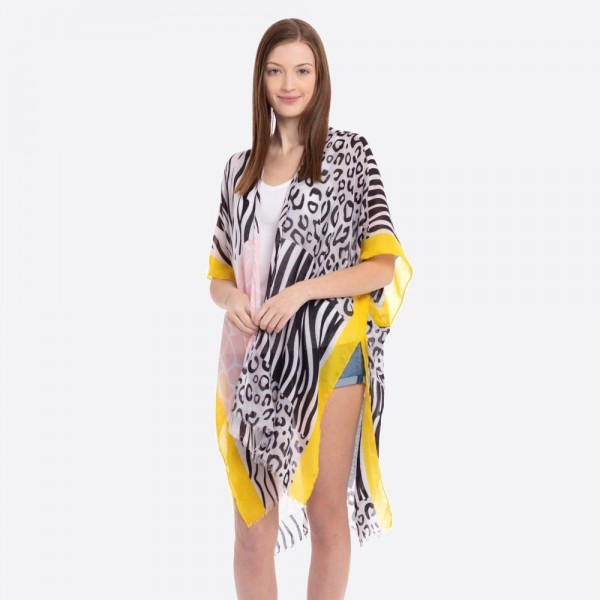 """Women's lightweight multicolor animal print kimono.  - One size fits most 0-14 - Approximately 37"""" L - 100% Polyester"""