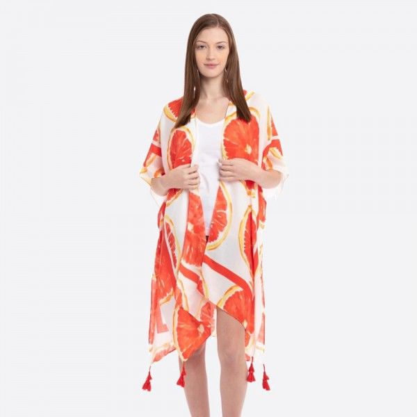 "Women's lightweight grapefruit tassel kimono.  - One size fits most 0-14 - Approximately 37"" L - 100% Polyester"