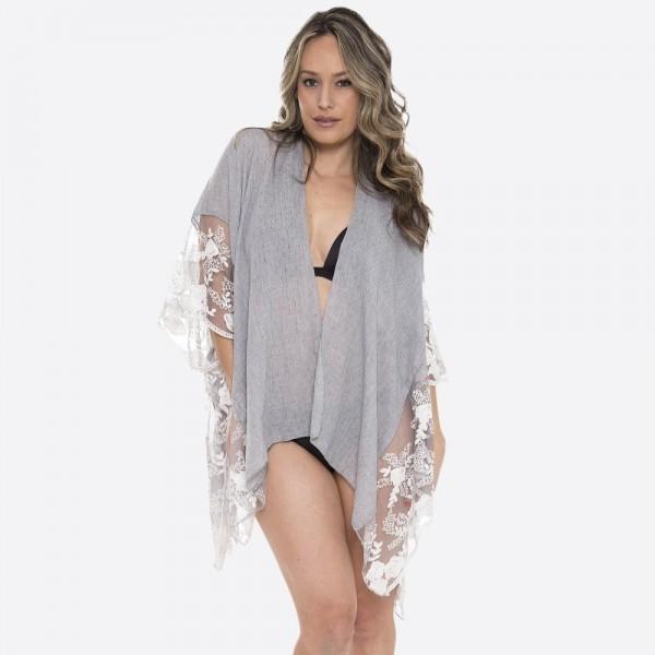 "Women's lightweight short lace kimono.  - One size fits most 0-14 - Approximately 27"" L - 100% Viscose"