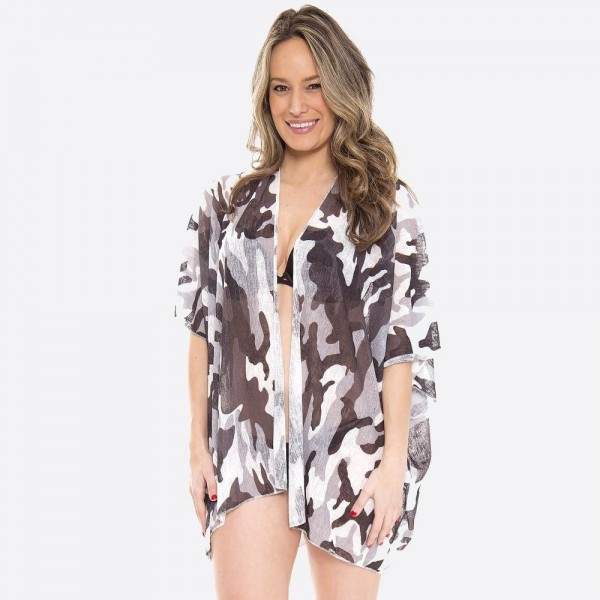 """Women's lightweight camouflage kimono.  - One size fits most 0-14 - Approximately 30"""" L - 100% Polyester"""