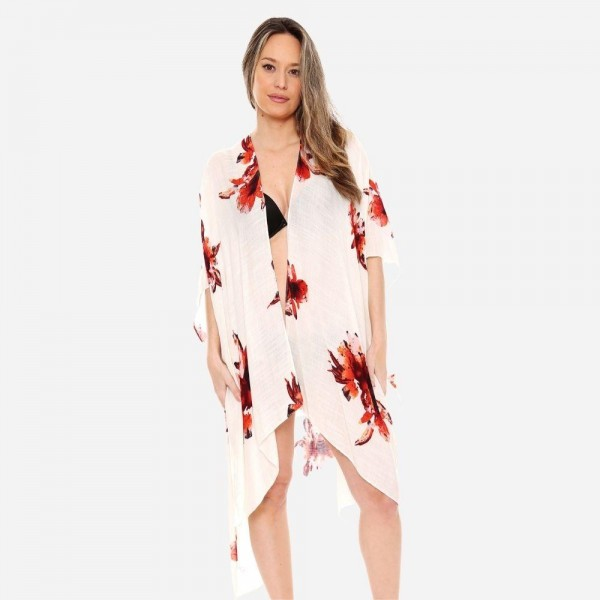 """Women's lightweight sheer floral kimono.  - One size fits most 0-14 - Approximately 37"""" L - 100% Viscose"""